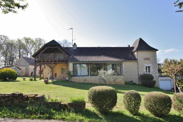SARLAT - IN A QUIET AND PEACEFUL ENVIRONMENT, PROPERTY OF EXCEPTION COMPOSED OF A STONE MAIN HOUSE,